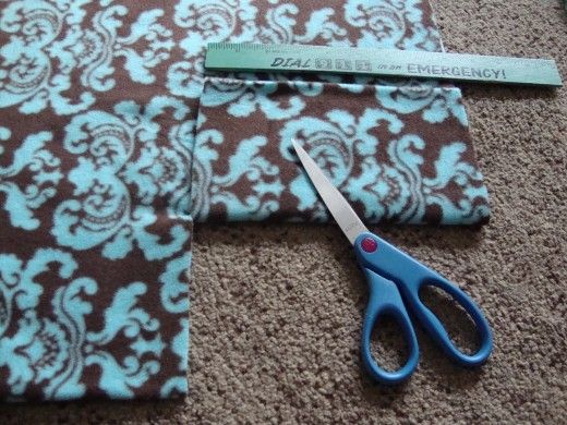 If you need an easy, inexpensive idea for gift-giving, here it is. You can make no-sew fleece fabric scarves for adults and children. It only takes minutes to make, and costs very little.