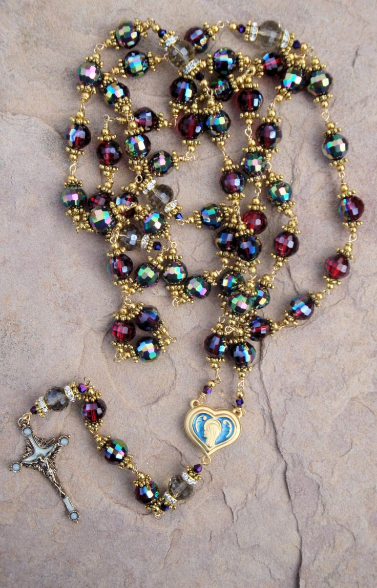 Handmade rosary with red Crystal beads with a heart center the center has holy water from the holy shine of Lourdes France by OurLadysGift on Etsy