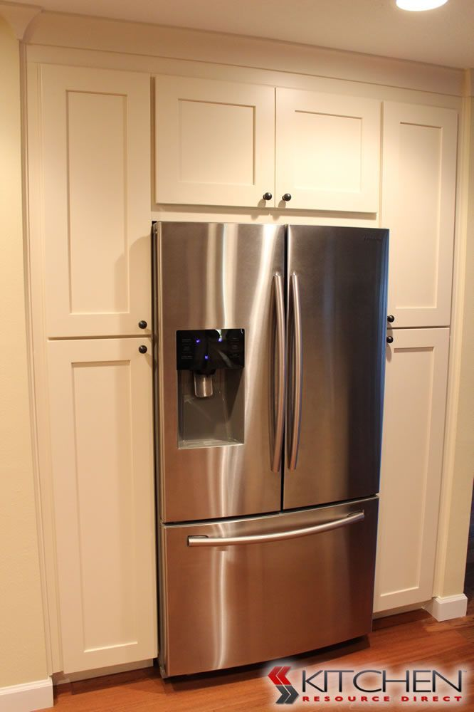 large pantry area around from kitchen cabinet fridge