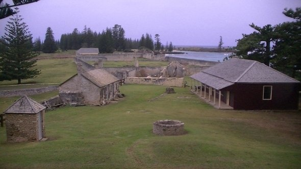 Norfolk Island (Territory of Australia) Some of the buildings in the foreground have been restored and are used as museums and storage areas for the equipment used to unload the ships. Many of the buildings in the colony were built with rock that was mined by convicts from Nepean Island in the background and the reef that lies between it and Kingston.