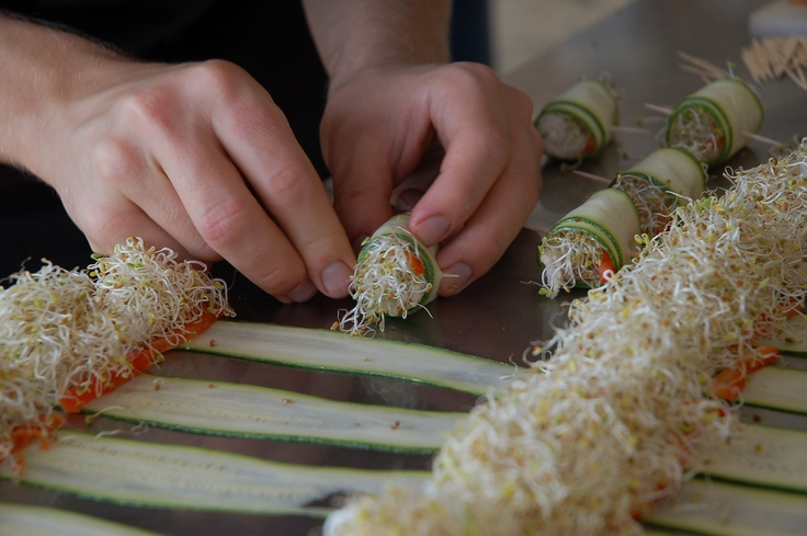 Alexander rolling the zucchini sprouts, red pepper and raw ricotta (made from brazil nuts)