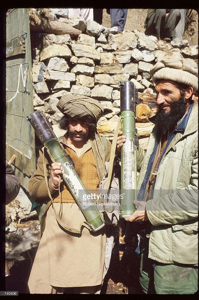 Guerrilla soldiers pose with shells at a remote base in the Safed Koh mountains February 10, 1988 in Afghanistan. A Soviet-supported communist coup by the People's Democratic Party of Afghanistan led to the USSR's 1979 invasion of the Islamic nation, resulting in ten years of civil war between the Russian-led Government and the US-backed Afghan rebels.