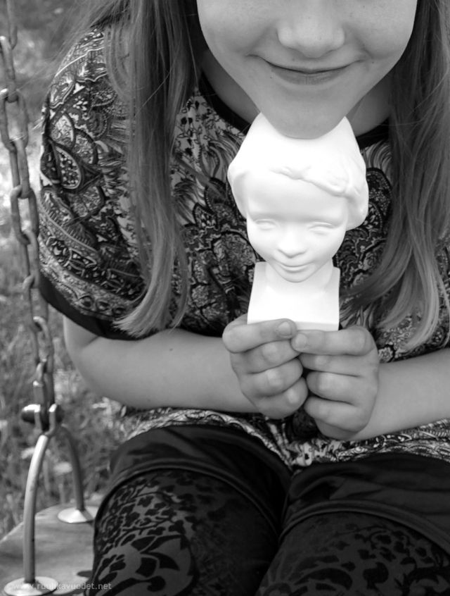 #Hymytyttö-patsas, The Smiling Girl statue is a Finnish traditional award given to a girl in the 4th grade, which her classmates find fair and trustworthy.