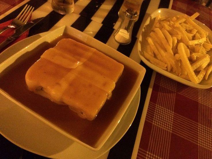 Dom Tacho - Francesinha acompanhada com batatas | Address: Rua David de Sousa 19, 1000-105 Lisbon, Portugal Roma-Areeiro  Phone number +351 216 036 166