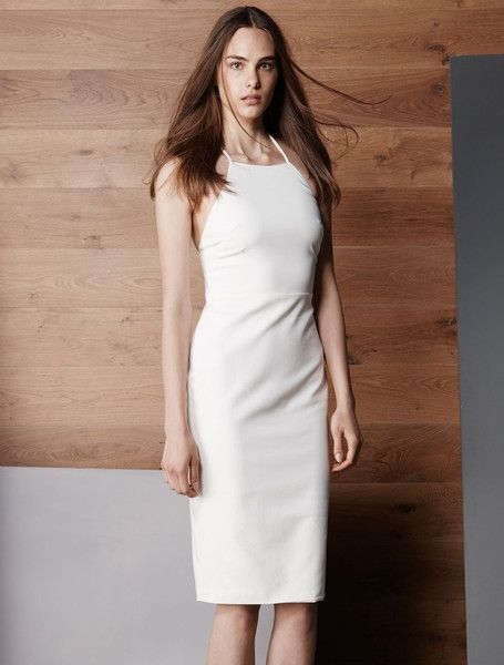 ISLA NIGHTLIFE DRESS from the Vivid Collection. Dominate the dress game this season with this crisp LWD. Crafted with a touch of stretch to guarantee a form fitting silhouette, this little white dress has a high trapeze neckline and modest midi hem. Let your back do the talking as you turn to reveal an open shoulder and backline, with fine strap detail to add to the allure. $159.00 available from www.islalabel.com #islalabel #fashion #style #lwd #party