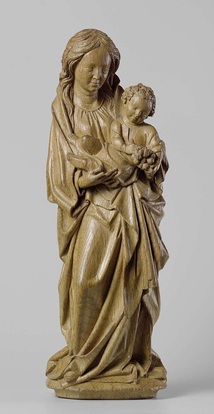 Adriaen van Wesel   Virgin and Child, Adriaen van Wesel, c. 1470 - c. 1480   Op een vierzijdige plint, die zich onderaan versmalt, staat Maria met het gebogen rechterbeen iets naar voren, waardoor haar bovenlichaam wat naar links overhelt. Met beide handen draagt zij het op de linkerheup zittende en naar de beschouwer gerichte kind, dat halfliggend is uitgebeeld. Het schijnt met de rechterhand een druif te plukken van de tros, die het met zijn linker vasthoudt en waarop zijn blik schijnt te…