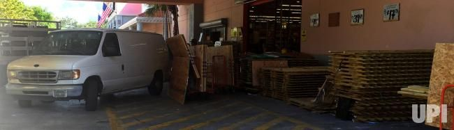 Carts loaded with wood to be used for shutters are stacked up waiting for drivers to load their vehicles from the Home Depot in Delray…