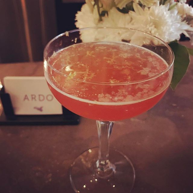 """At Ardo enjoying Charlie's creation """"The Duchess of Bologna"""". Gorgeous combination of Tanqueray, Amaro Montenegro, Byrrh, rhubarb and grapefruit bitters topped with a lemon zest. @ardorestaurant @the_schway81 #happyhour #cocktailtime #cocktails #cocktailporn #cocktailhour #tanqueray #amaromontenegro #byrrh #craftcocktails #ardo #toronto #the6ix #thesix #thefeedfeed #imbibegram #imbibe #cocktailculture #cocktailcreations #local"""