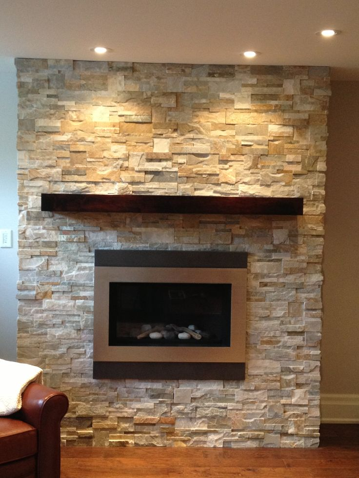 Wood Mantel And Natural Ledge Stone On Fireplace Stone