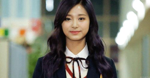 This is a gif of Tzuyu from the Kpop girl band TWICE.