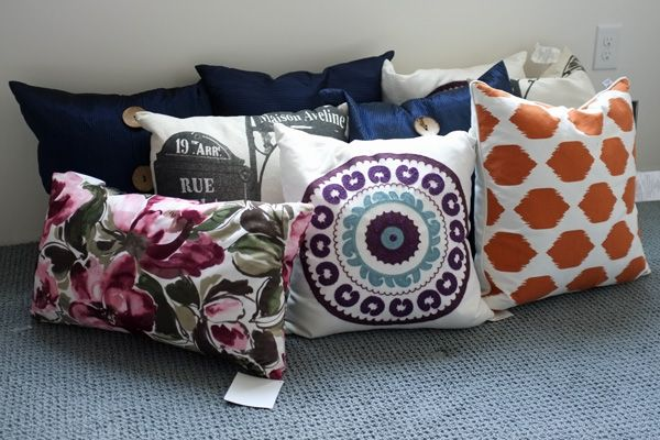 Buy ugly pillows at home goods stores on clearance and then only use the insides and sew new covers - way cheaper than buying forms