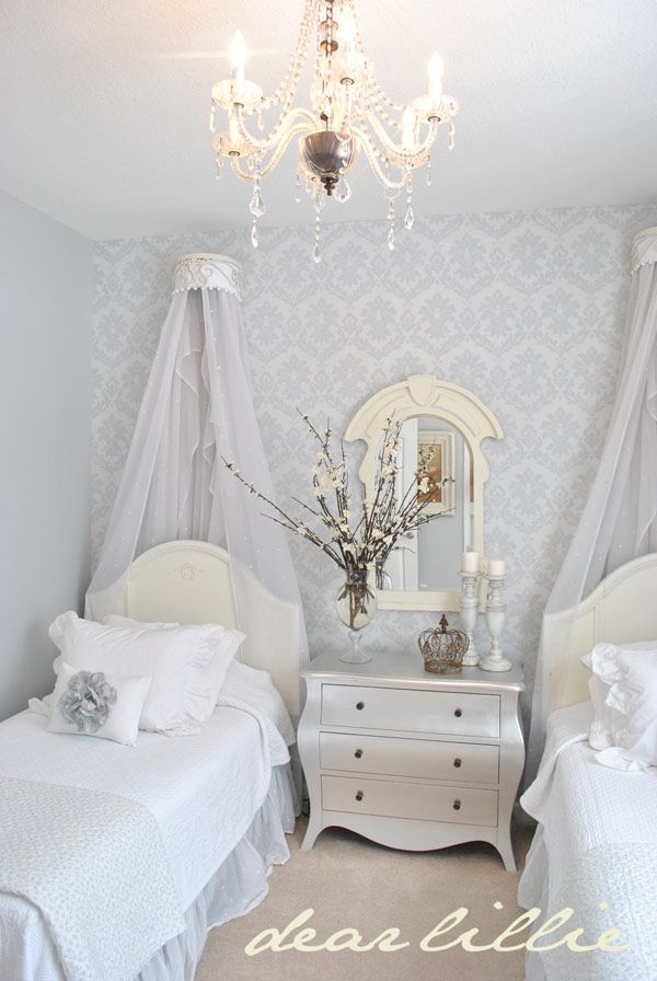 Unique details add to the romantic atmosphere in this gray & white bedroom.