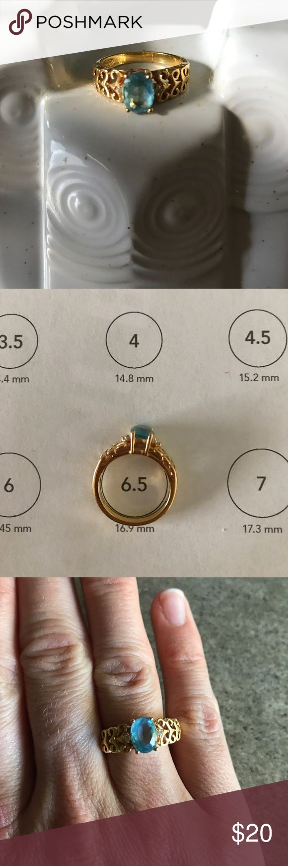 "Avon ring with blue ""topaz"" stone Unsure of materials - selling for my mom seems to be a 6.5 by printable online ring sizer. •Please note this size is approx• Very pretty with slight scratching/wear and I could find no tarnishing. Could use a cleaning. Avon Jewelry Rings"