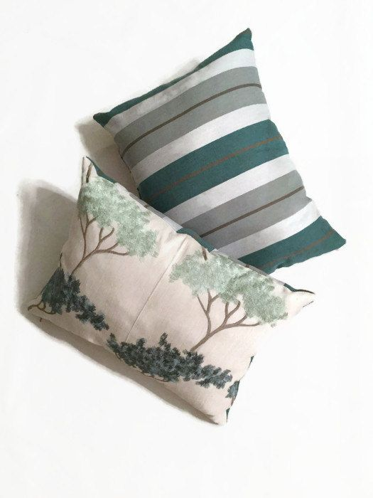 Interior decorating ideas!  Decorative couch pillow embroidered with chic navy and teal tree pattern and shophisticated linen striped fabric on the back. Bonsai Garden in Mineral luxury decorative pillow by MyCusionBoutique.