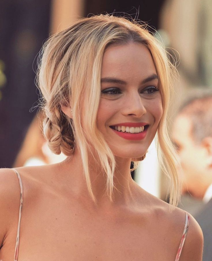 Loose low bun hairstyle on Margot Robbie