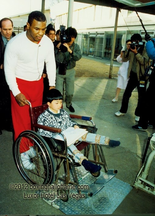 Mike Tyson in Japan for the Tony Tubbs fight March 1988. Mike visited many hospitals and children's clinics.  boxinghalloffame.com