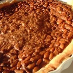 The creamy white pine nut lends its sweet rich flavor to a pie that is very much like a pecan pie. Lots of sugar -both brown and white - and eggs, butter, flour and cream are stirred together. Then the mixture is combined with the nuts, poured into a waiting crust, and baked until set and golden.