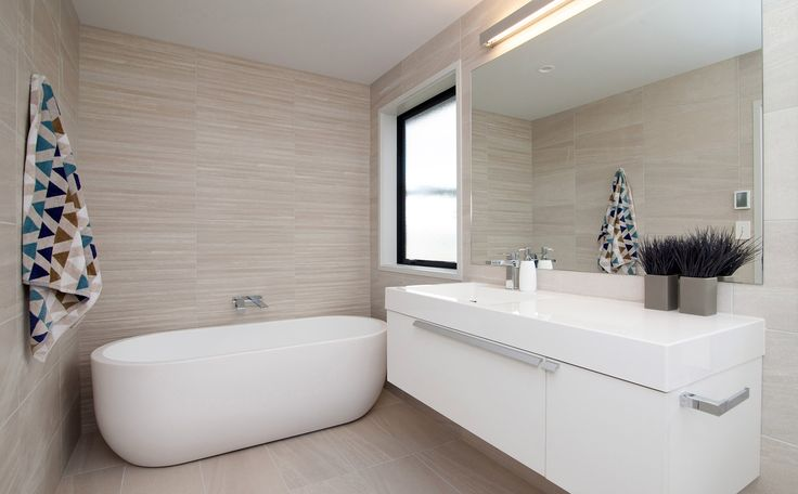 Beautifully tiled main bathroom with freestanding bath!