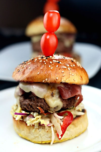 Burgers with Pastrami, Spicy slaw, swiss cheese,and the best homemade burger buns ever!