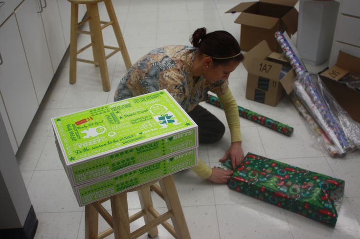 Nicolette busy wrapping gifts #Animal Hospital #Veterinarian #Pets #Vet #KAH #FrederickMaryland #Christmas #GivingBack