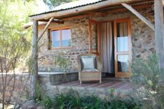 Welbedacht Game and Nature Reserve, Tulbagh. All cottages are well spaced and secluded with shady verandas, private mountain water plunge pools, log fireplaces and braais.