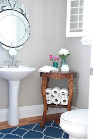 Make use of the corners in a powder room - this beautiful wooden stool doubles up as a storage container!