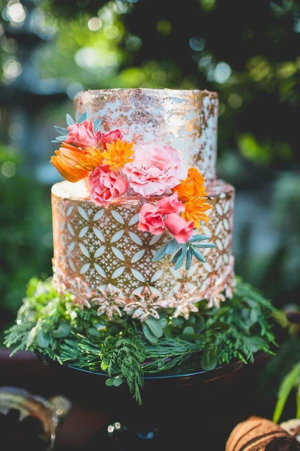 Boho is mostly inspired by Southwestern elements, but it also gets a lot of influence from Moroccan design. Infuse your wedding cake with both by finding a design that incorporates all aspects of boho's roots like this gold metallic wedding cake with bright floral cake toppers.
