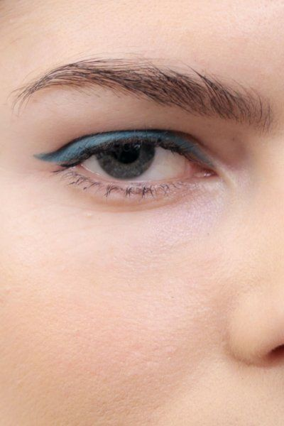 Beauty GIF: How to Wear Teal Eyeliner. Inspired by Lupita Nyong'o's glorious indigo eyeliner from the Screen Actors Guild Awards and a pretty teal eyeliner from Stila's new Spring offerings, the Cut asked Sarah Lucero, Stila's Global Creative Director of Education, to show us how to wear a bright blue eye.