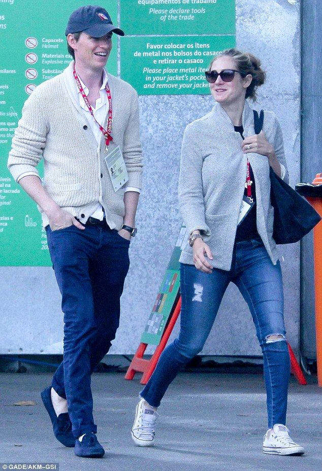 Couple who dress together! Eddie Redmayne and his publicist wife, both 34, looked ready to cheer on Team GB in matching cardigans as they headed to the park in Rio on Thursday