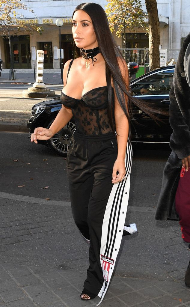 Ready to Run from All the Kardashians' Paris Fashion Week Looks  The mom of two paired a black lace corset with Adidas track pants and long, straight tresses.