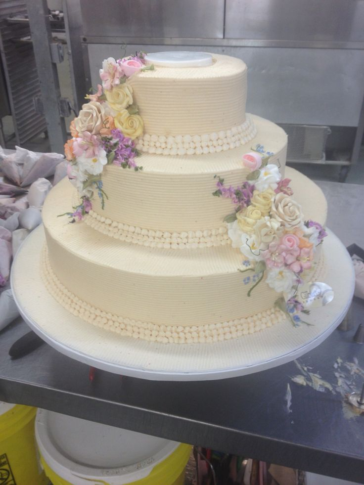 Simple 3 Tier Cake In Beige With Three Strand Ercream Pearl Border 2 Bouquets Caketiered Cakesgum Paste Flowerspastel Colors Wedding