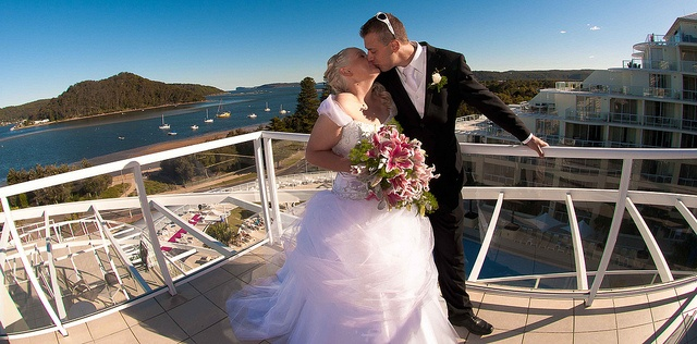 A happy newlywed couple on the balcony of the Mantra Resort at Ettalong Beach by Edward Yd via Flickr.