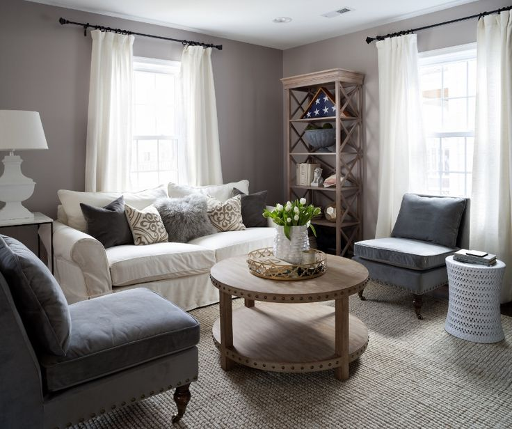 """When Jennifer Schmidt, the interior designer behind JWS Interiors, was approached by a couple of new homeowners to transform their space, she was met with a total blank slate. """"When I showed up, the house was completely gutted,"""" Jennifer says. """"It was exciting to start from scratch, and the owners knew they wanted something neutral and comfortable, but pretty.""""  A Welcoming Living Room Neutral hues like crisp white and cozy grays sound safe in theory, but Jennifer knew that the look could…"""