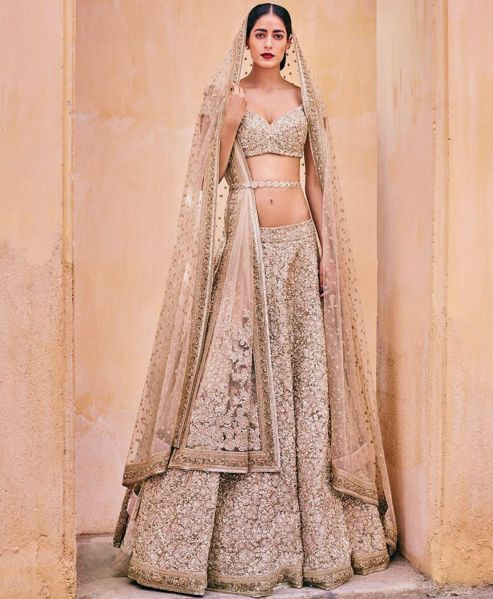 Buy replica of Sabyasachi gold bridal Lehenga choli 2016- 2900$ USD- http://www.gujaratidresses.com/sabyasachi-bridal-lehenga-choli-2016/