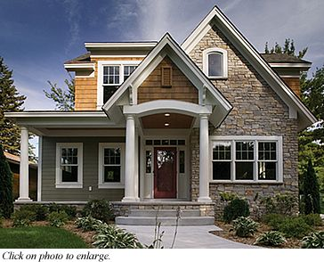 Gray with stone, white trim and wooden shakes