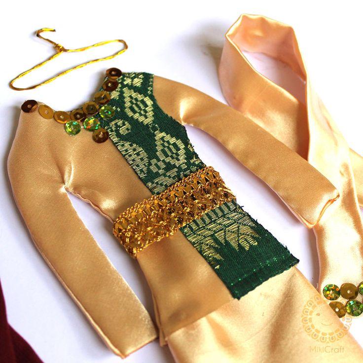 Riau melayu women traditional costume with batik tenun songket