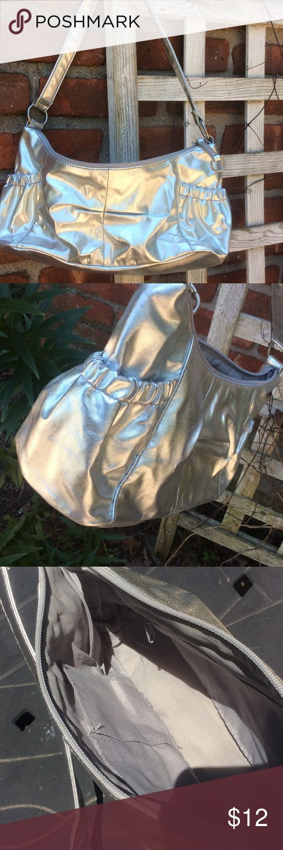 Silver purse / pocketbook NWOT Silver purse / pocketbook. Hasn't been used, but has been stored. Could not find any visible defects. Side pockets for storage. Bags Shoulder Bags