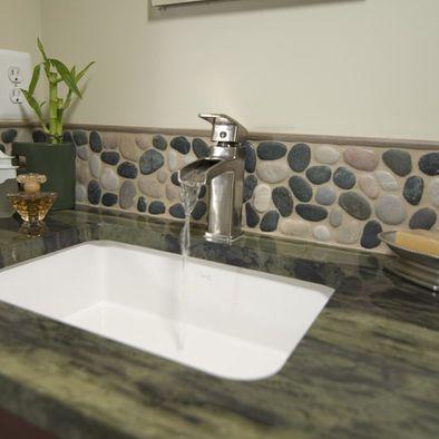 bathroom river rock backsplash and dark counter. beautiful ideas. Home Design Ideas