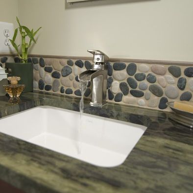 river rock backsplash and dark counter