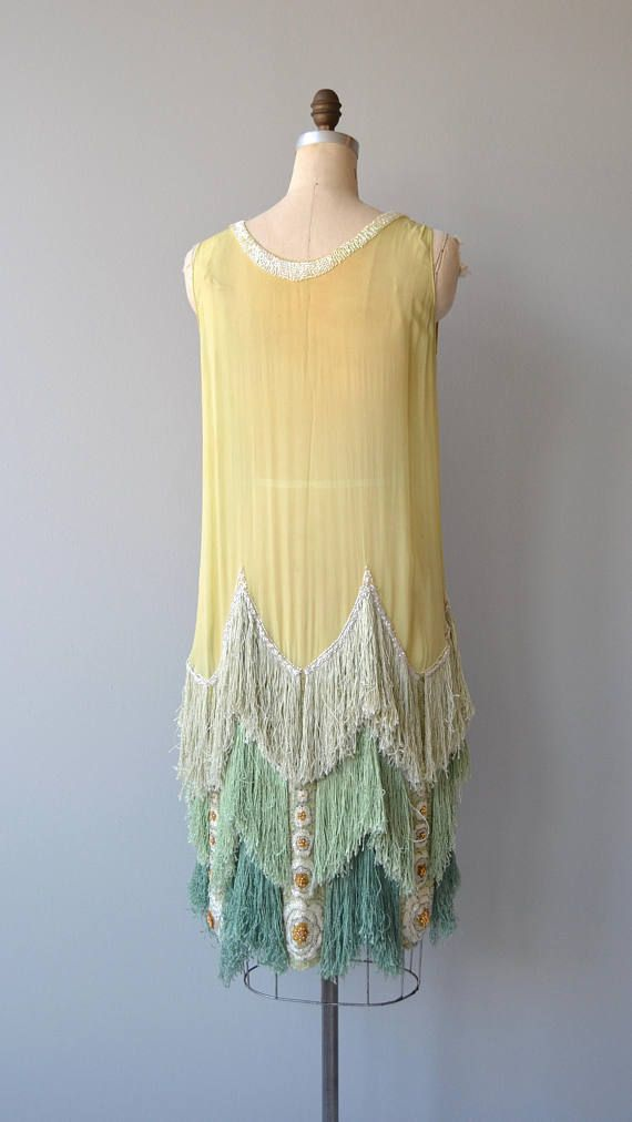 Antique 1920s chartreuse and shades of spring green silk dress with white beaded collar, stationary bow and exceptional heavily beaded and silk fringed hem. --- M E A S U R E M E N T S ---  fits like: small/medium bust: best fit up to 39 waist: best fit up to 35 hip: best fit up to 40.5 length: 40 brand/maker: n/a condition: very good, some discoloration under arms and neckline, one small hole on skirt  ➸ More tops & sweaters https://www.etsy.com/shop/De...