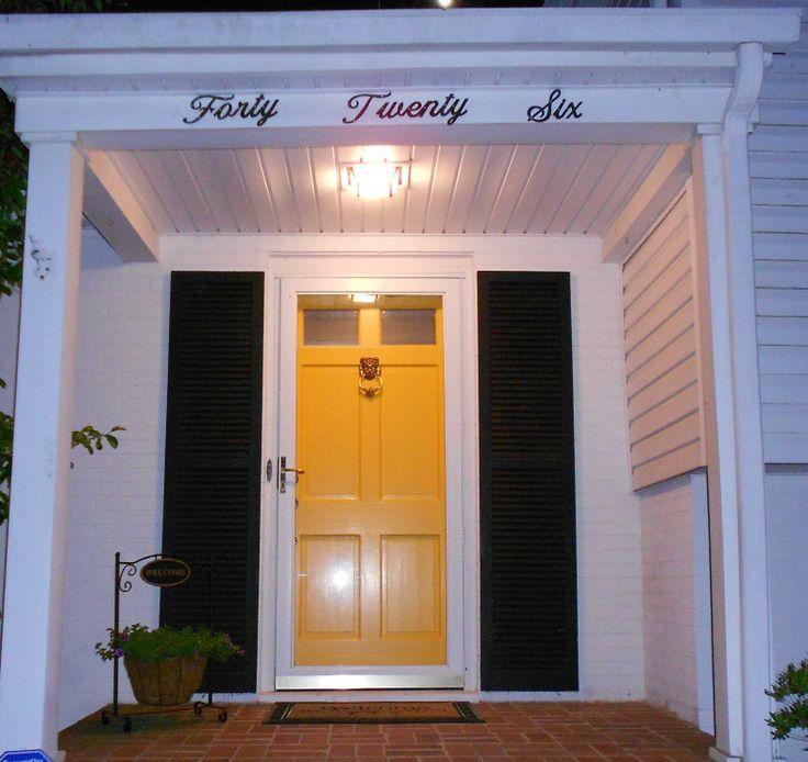 White House Black Shutters Yellow Front Door Yellow