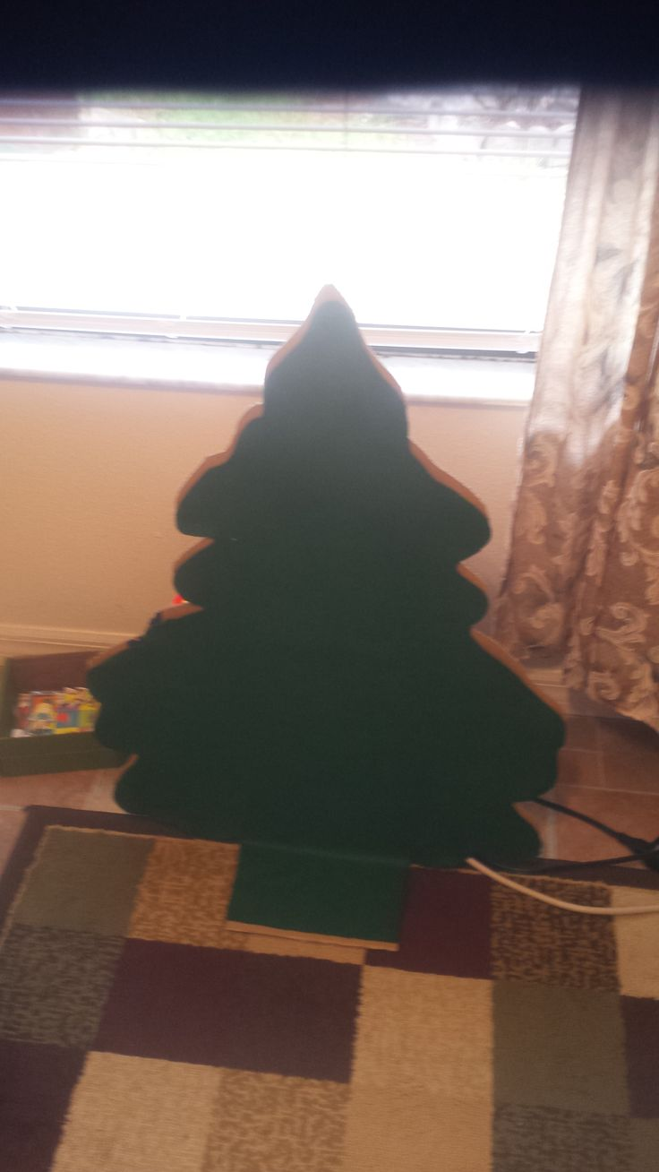 large felt tree that can be used for different seasons for the children to decorate. Using apples, leaves and Christmas decorations