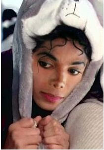 Michael Jackson with an animal hat on.