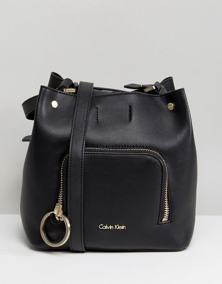 Get this Calvin Klein's bombonera bag now! Click for more details. Worldwide shipping. Calvin Klein Bucket Bag with Ring Detail - Black: Bag by Calvin Klein, Faux-leather outer, Lining, Single strap, Front top closure, External pocket, Interior slip pocket, Wipe clean, 100% Polyurethane. The epitome of minimalist chic, Calvin Klein transfers his love of clean lines seamlessly across the label�s accessory and lingerie collection. Chicly functional purses and bags sit alongside seamless…