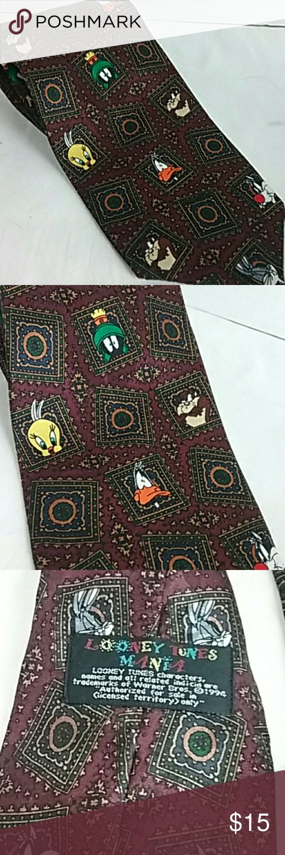 Looney Tunes Burgundy Tie Bugs Marvin Taz Tweety Looney Tunes themed burgundy tie with Kaz Bugs Bunny Tweety Bird Marvin the Martian and Daffy Duck. 100 % polyester. Excellent previously owned condition no rips stains or tears. Looney Tunes Accessories Ties