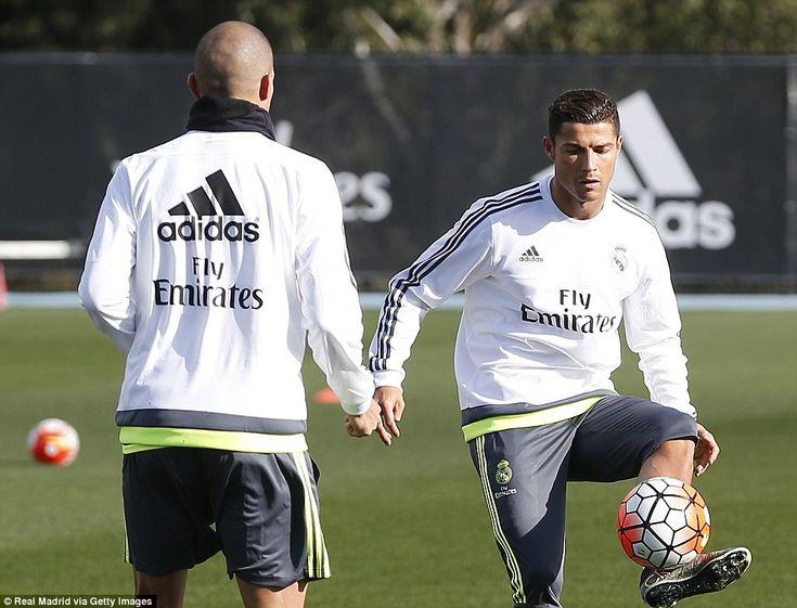 Cristiano Ronaldo trains alongside his Real Madrid and Portugal team-mate Pepe during a tr...