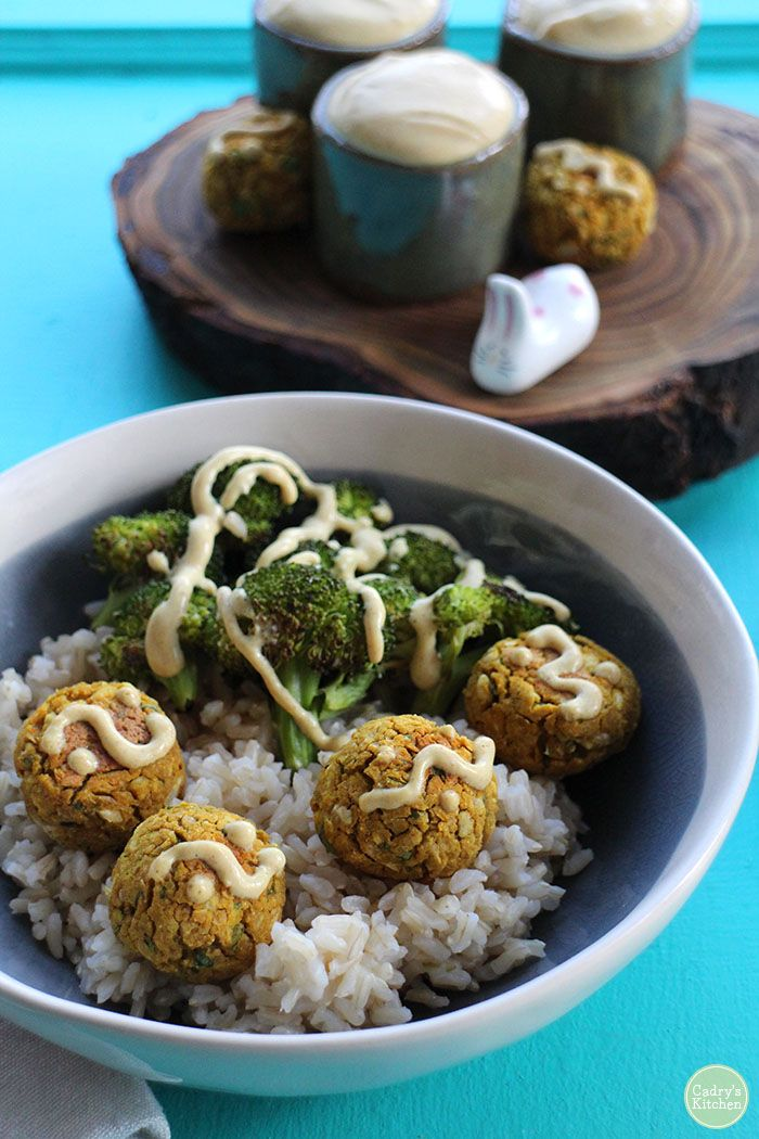 Indian-inspired falafel bowl with roasted broccoli, brown rice, and a creamy curry peanut sauce. Vegan, gluten-free, and delicious! | cadryskitchen.com: