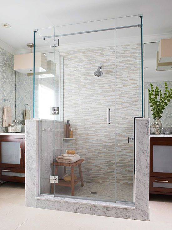 With only a small corner shelf as a holding area, this walk-in shower benefits from the addition of a teak bench shower seat. Set near the shower's entry, the bench holds sponges and towels until the bench is needed as a seat for relaxing amidst water streaming from the wall-mount showerhead./