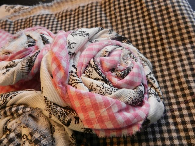 DIY: Use two coordinating fabric scraps to create fabric roses. Link is at PB pillow knockoff.