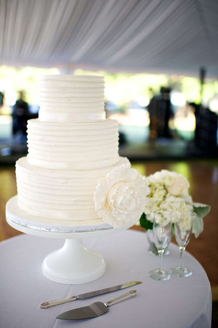 Simple, classic white wedding cake with large flower   Sherri's Edible Designs   Scott Hopkins Photography #weddings